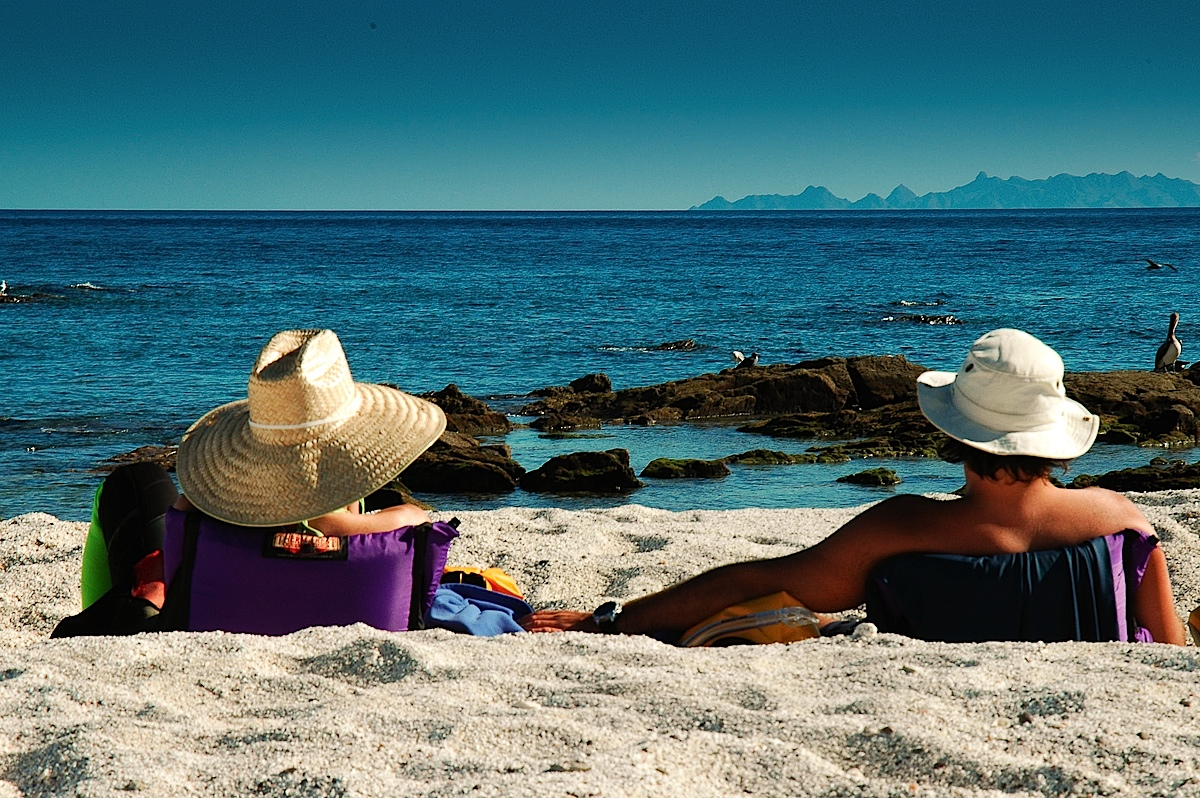 Couple-enjoying-holidays-on-beach