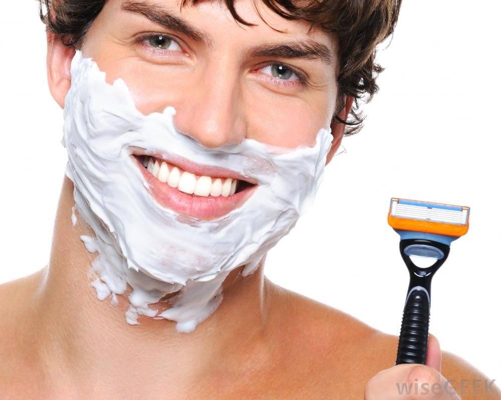 man-with-shaving-cream-on-face-holding-razor